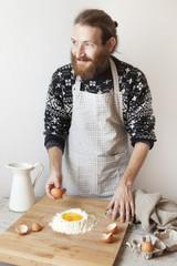 bearded stylish man with apron making dough for fresh pasta