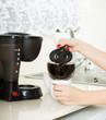 girl   making coffee.closeup
