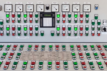 Many buttons and switches - control panel in a machine