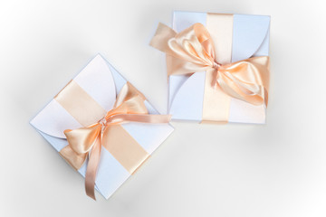 Two boxes with pink bows