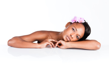 Beautiful African woman in Studio doing body care