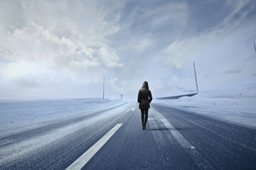 Woman in a snowy road