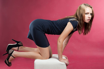 attractive slender graceful girl on her knees