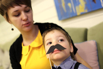 Boy with toy moustache