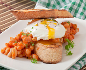 Breakfast poached egg with toast, baked beans with tomato sauce