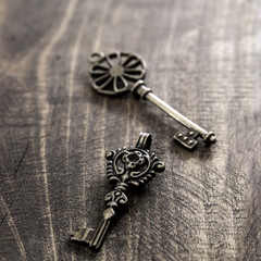 old vintage keys on rustic wooden background