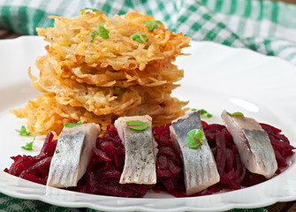 Fragrant potato pancakes and herring with beetroot