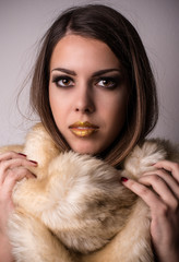 Attractive young woman wearing winter fur fashion