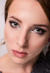beauty portrait of a young grey eyed woman