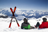 Young happy couple lying in snowy mountains