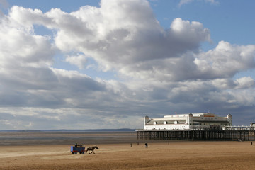 Low tide at the traditional seaside pier at Weston-super-mare UK