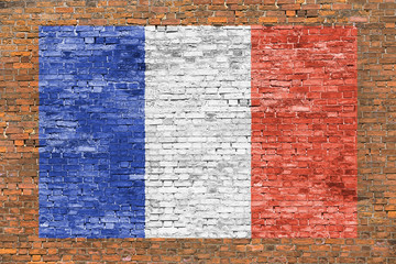 Flag of France painted over brick wall