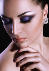 Beauty portrait of girl with violet make up and brilliant