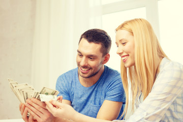 couple with money at home