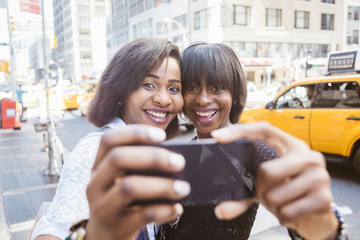 Two Beautiful Black Woman taking Selfie in New York