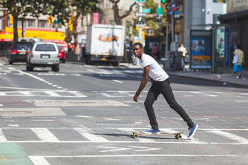 Black Boy Skating with Longboard on the Road
