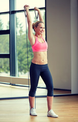 smiling woman with expander in gym