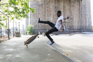 Black Boy Skating at Park and Falling Down