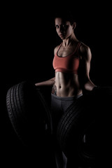 fitness girl with two tyres