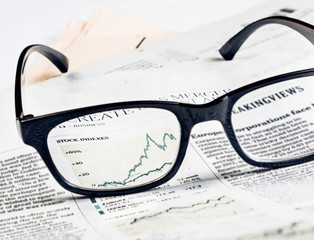 financial chart of stock indexes see through glasses lens