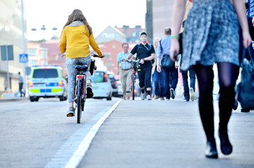Female bicyclist on her way home