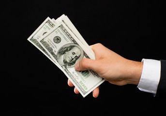 close up of male hands holding dollar cash money