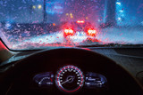 Blurry car silhouette seen through snowy and wet windscreen poster