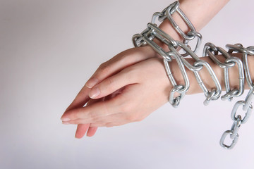 female hands tied by chain
