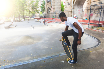 Black Boy Skating at Park with Longboard