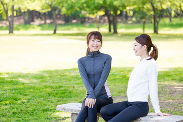 young asian women relaxing in the park