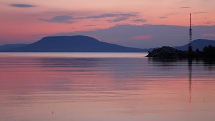 Twilight on Balaton lake with Badacsony and soft water ripples