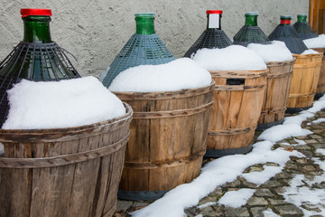 wine's carboys covered by snow