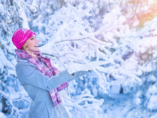 Cute girl enjoying snow