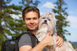 Young man tourist with dog