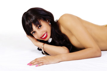 Reclining Topless Attractive African American Woman Smiling