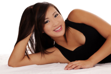 Smiling Asian American Teen Girl Reclining On Side