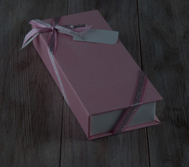 Pink Gift Box  on Rustic Wooden Background