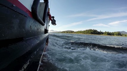 First person POV of fishing boat on river