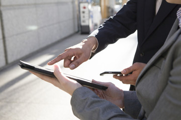 Men pointing the electronic tablet