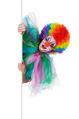 smiling female clown posing behind a blank panel