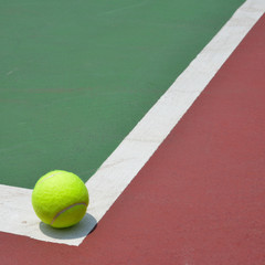 tennis ball on green court