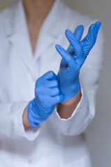 Doctor wearing protective gloves