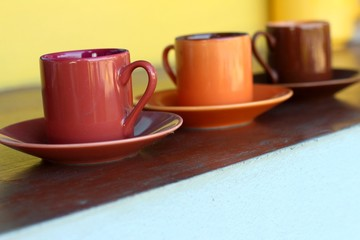 Ceramic coffee set plate at glass shop.