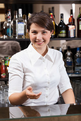 Smiling girl working in hotel bar