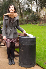 young woman throwing rubbish in the bin