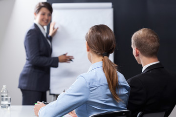 Employees listening interesting presentation