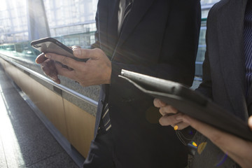 Hand of businessman that have a cell phone