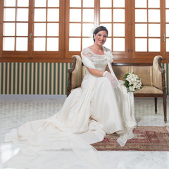 Nice Young Bride Sitting in a Sofa
