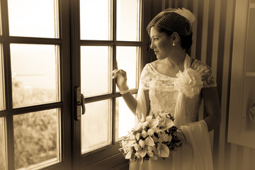 Young Bride Looking Out of a Steamy Window. Monochrome.
