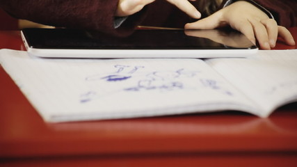 Little girl school tablet close-up